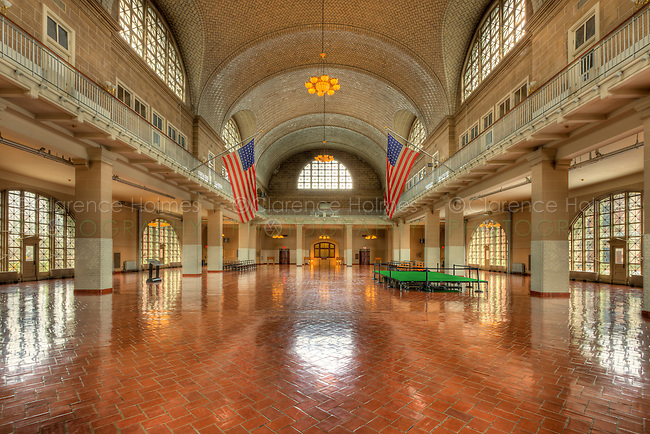 A view of the Ellis Island Registry Room (the Great Hall) inside the Ellis Island Immigration Museum.  The Museum is part of the Statue of Liberty National Monument.
