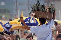 Beach vendor sells pineapple at Ipanema beach, Rio de Janeiro, Brazil.