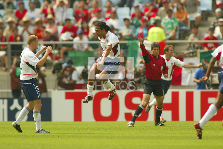 Pablo Mastroeni prepares to leap into the arms of John O'Brien as the referee calls time at the end of the game. The USA defeated Mexico 2-0 in the Round of 16 of the FIFA World Cup 2002 in South Korea on June 17, 2002.