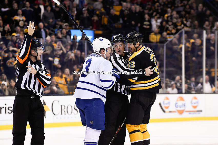 Saturday, November 21, 2015: Boston Bruins defenseman Zdeno Chara (33) and Toronto Maple Leafs defenseman Dion Phaneuf (3) are separated by linesman Matt MacPherson (83) during the National Hockey League game between the Toronto Maple Leafs and the Boston Bruins held at TD Garden, in Boston, Massachusetts.  Eric Canha/CSM