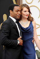 HOLLYWOOD, CA - MARCH 2: Chiwetel Ejiofor, Sari Mercer  arriving to the 2014 Oscars at the Hollywood and Highland Center in Hollywood, California. March 2, 2014. Credit: SP1/Starlitepics. /NORTePHOTO