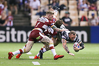 Picture by David Neilson/SWpix.com/PhotosportNZ - 10/02/2018 - Rugby League - Betfred Super League - Wigan Warriors v Hull FC  - WIN Stadium, Wollongong, Australia - Hull FC's Josh Griffin is tackled by Wigan's Dan Sarginson & Sam Tomkins.