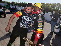Sep 29, 2013; Madison, IL, USA; NHRA top fuel dragster driver Antron Brown celebrates with crew after winning the Midwest Nationals at Gateway Motorsports Park. Mandatory Credit: Mark J. Rebilas-