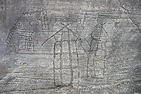 Prehistoric Petroglyph, rock carving, of what is known as the Map of Bebolina with depictions of huts raised on wooden poles  carved by the Camunni people in the iron age between 1000-1600 BC, Bedolina Rock no 1 , Seradina-Bedolina Archaeological Park, Valle Comenica, Lombardy, Italy