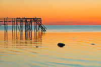 Pier (dock) on Lake Winnipeg at sunrise<br />