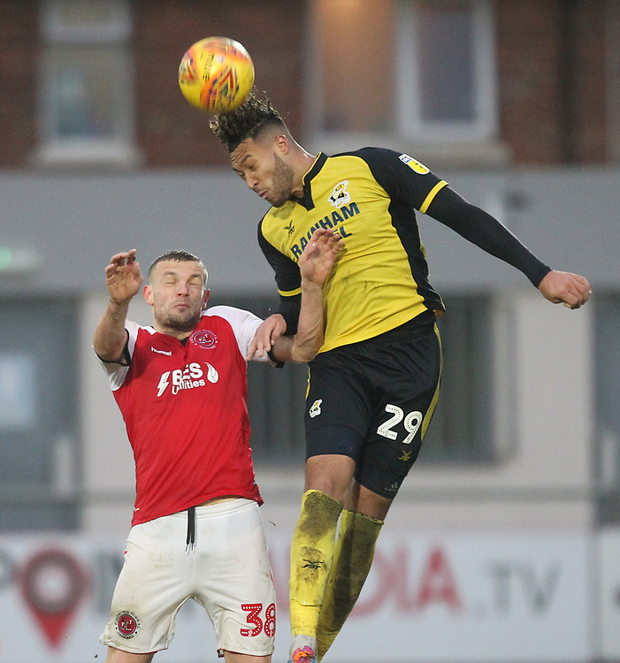 Fleetwood Town's James Wallace  jumps with  Scunthorpe Utd's Kyle Wootton<br /> <br /> Photographer Mick Walker/CameraSport<br /> <br /> The EFL Sky Bet League One - Fleetwood Town v Scunthorpe United - Saturday 26th January 2019 - Highbury Stadium - Fleetwood<br /> <br /> World Copyright © 2019 CameraSport. All rights reserved. 43 Linden Ave. Countesthorpe. Leicester. England. LE8 5PG - Tel: +44 (0) 116 277 4147 - admin@camerasport.com - www.camerasport.com