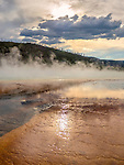 Steam rises from Grand Prismatic Spring at Midway Geyser Basin in Yellowstone National Park.