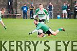 Ballyduff's Barry O'Grady wins the ball from Ballydonoghue's Jason Foley.