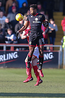 Chuks Aneke of MK Dons wins the aerial battle during the Sky Bet League 1 match between Fleetwood Town and MK Dons at Highbury Stadium, Fleetwood, England on 24 February 2018. Photo by David Horn / PRiME Media Images