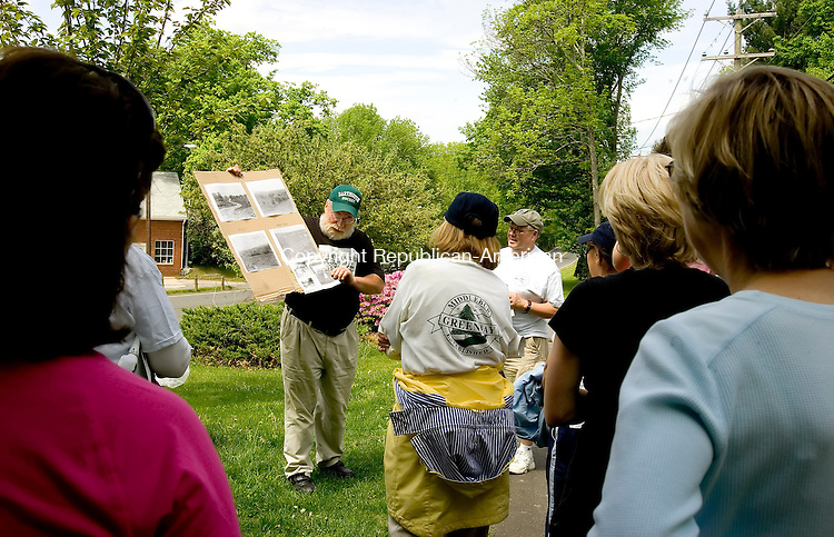 MIDDLEBURY, CT--20 MAY 2007--052007JS08- Robin Fenn displays copies of old family photographs while giving a history of the Middlebury Greenway for a Bicentennial Historical Walk along the Greenway on Sunday. The Greenway was once a trolley line that ran from Waterbury to the amusement park and beyond. <br /> Jim Shannon / Republican-American