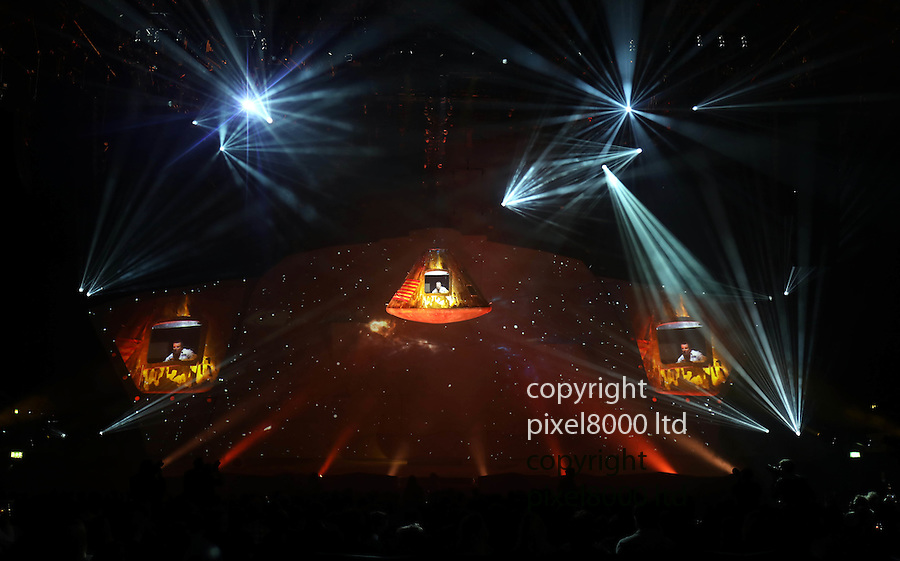 """Pic shows: Bear Grylls - Endeavour show - dress rehearsal for his new show at Wembley Arena<br /> 6/10/16<br /> He brings his son Huckleberry to the stage to re-enact the Apollo 13  mission and has them both flying through """"space"""" on wires high above the stage whilst they fix the lunar module<br /> <br /> Pic by Gavin Rodgers/Pixel 8000 Ltd"""