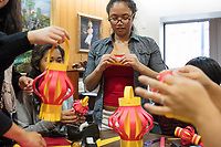 Cynthia Tim, 20, (center) and Socheata Mam, 19, (left, seated) create paper lantern crafts at a Lunar New Year celebration at Middlesex Community College's Asian American Connections Center on Thurs., Feb. 15, 2018. Tim is a Cambodian-American and a second year student at Middlesex Community College studying Business. Mam is a Cambodian-American first year student studying Criminal Justice. The Asian American Connections Center was established at the school using a federal grant in 2016 and serves as a focal point for the Asian community at the school, predominantly Cambodian, to gather, socialize, study, and otherwise take part in student life.