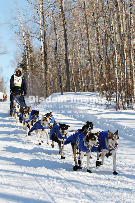 DULUTH, MN - FEBRUARY 2:  Ryan Anderson and his dog team race down a hill a few minutes from the finish line of the John Beargrease sled dog marathon February 2, 2011 in Duluth, Minnesota.  After3 days of racing over hundreds of miles Anderson beat second place finisher Nathan Schroeder by 20 seconds.  (Photograph by Jonathan P. Larsen)