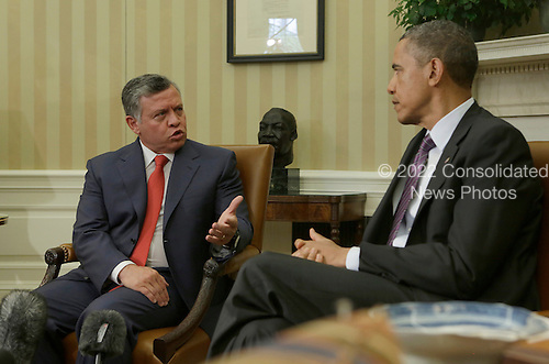 King Abdullah II of Jordan makes a statement on Syria, April 26, 2013 before holding a bilateral meeting with United States President Barack Obama at the White House in Washington, DC. .Credit: Chris Kleponis / Pool via CNP