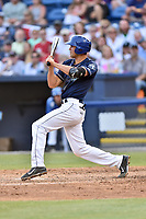 Asheville Tourists first baseman Jacob Bosiokovic (21) checks his swing during a game against the Greenville Drive at McCormick Field on April 15, 2017 in Asheville, North Carolina. The Tourists defeated the Drive 5-4. (Tony Farlow/Four Seam Images)