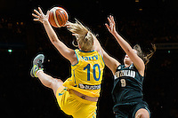 Melbourne, 15 August 2015 - Rachel JARRY of Australia blocks a shot by Stella BECK of New Zealand in game one of the 2015 FIBA Oceania Championships in women's basketball between the Australian Opals and the New Zealand Tall Ferns at Rod Laver Arena in Melbourne, Australia. Aus def NZ 61-41. (Photo Sydney Low / sydlow.com)