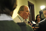 Nassau County Legislature, controlled by Republicans, votes along party lines to consolidate 8 police precincts into 4, on Monday, March 5, 2012, at Mineola, New York, Nassau County Legislature Presiding Officer and Majoriy Leader Peter Schmitt (center) told Press he did not expect backlash over voting to close precincts.
