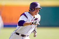 Kyle Pollock (5) of the Evansville Purple Aces rounds third base during a game against the Indiana State Sycamores in the 2012 Missouri Valley Conference Championship Tournament at Hammons Field on May 23, 2012 in Springfield, Missouri. (David Welker/Four Seam Images)