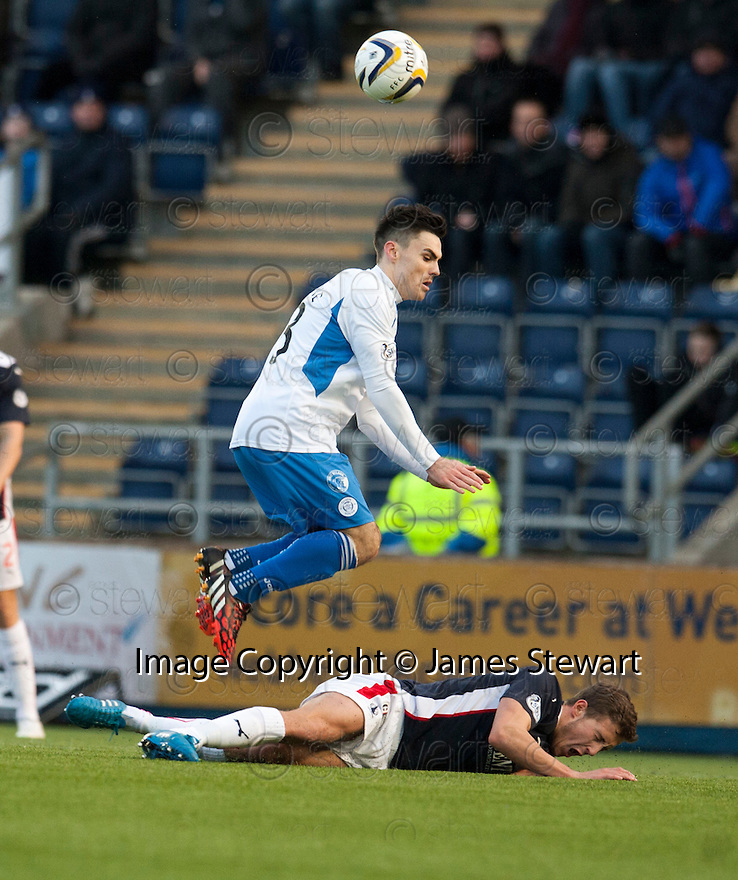 Queen of the South's Ian McShane is challenged by Falkirk's Will Vaulks.