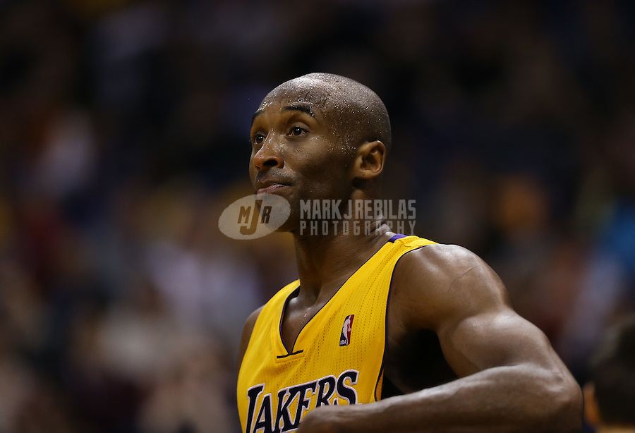 Jan. 30, 2013; Phoenix, AZ, USA: Los Angeles Lakers guard Kobe Bryant (24) against the Phoenix Suns at the US Airways Center. Mandatory Credit: Mark J. Rebilas-