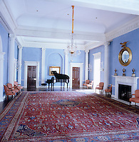 The music room, its walls adorned with neo-classical columns, pilasters and moulded cornice decoration