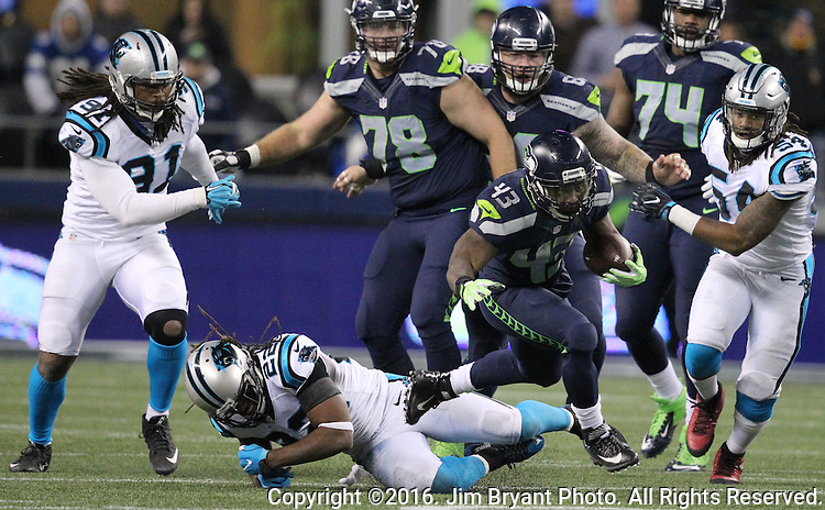 Seattle Seahawks running back Troymaine Pope (43) runs through the attempted tackle of Carolina Panthers free safety Michael Griffin (22) at CenturyLink Field in Seattle, Washington on December 4, 2016.  Seahawks beat the Panthers 40-7.  ©2016. Jim Bryant photo. All Rights Reserved.