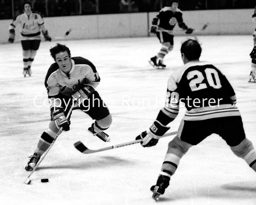 Seals Hilliard Graves against Boston Bruins Dallas Smith. (1973 photo/Ron Riesterer)