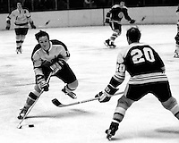 Seals Hilliard Graves against Boston Bruins Dallas Smith. (1973 photo/Ron Riesterer)