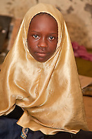 Zanzibar, Tanzania.  Young Boy in Madrassa (Koranic School).