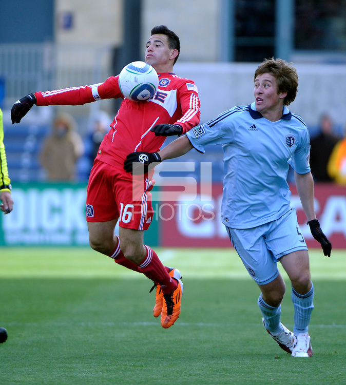 Chicago Fire midfielder Marco Pappa (16) chests the ball in front of Sporting KC defender Matt Besler (5).  The Chicago Fire defeated Sporting KC 3-2 at Toyota Park in Bridgeview, IL on March 27, 2011.