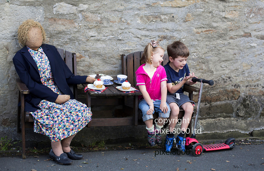 Scarecrow Festival at Kettlewell in Yorkshire 2013<br /> <br /> Old lady has friends over for tea<br /> <br /> Scarecrows are made by local community and places in and around their front gardens.  Competition is fierce but it's all to raise money  for the local church  and other local projects to benefit the whole community.<br /> <br /> <br /> <br /> Picture by Gavin Rodgers/ Pixel 8000 <br /> <br /> 07917221968