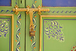 A decorative door and a gold door handle and lock in Marrakesh, Morocco.