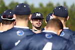 CARY, NC - FEBRUARY 23: Monmouth assistant coach Chris Collazo talks to his players. The Monmouth University Hawks played the Saint John's University Red Storm on February 23, 2018 on Field 2 at the USA Baseball National Training Complex in Cary, NC in a Division I College Baseball game. St John's won the game 3-0.