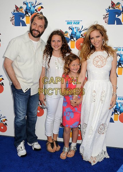 """JUDD APATOW, DAUGHTERS MAUDE & IRIS APATOW & LESLIE MANN .""""Rio"""" Los Angeles Premiere held at Grauman's Chinese Theatre,  Hollywood, California, USA, .10th April 2011.full length family children kids husband wife jeans  white shirt long maxi dress lace cut out .CAP/ADM/BP.©Byron Purvis/AdMedia/Capital Pictures."""