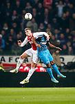 Nederland, Amsterdam, 1 december 2012.Seizoen 2012-2013.Eredivisie.Ajax-PSV .Toby Alderweireld (l.) van Ajax en Luciano Narsingh (r.) van PSV strijden om de bal.
