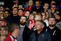 Lincoln City fans watch their team in action<br /> <br /> Photographer Chris Vaughan/CameraSport<br /> <br /> The Carabao Cup First Round - Huddersfield Town v Lincoln City - Tuesday 13th August 2019 - John Smith's Stadium - Huddersfield<br />  <br /> World Copyright © 2019 CameraSport. All rights reserved. 43 Linden Ave. Countesthorpe. Leicester. England. LE8 5PG - Tel: +44 (0) 116 277 4147 - admin@camerasport.com - www.camerasport.com