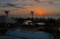 Hotel resort pool at dusk, Playa de las Americas, Tenerife, Canary Islands,
