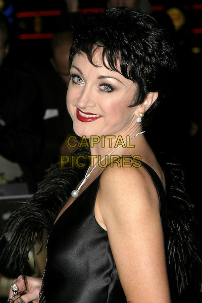 CAROLINE O'CONNOR.De-Lovely Charity Premiere, empire Leicester Square, London, September 29th 2004..portrait headshot black dress feathers feathered.Ref: AH.www.capitalpictures.com.sales@capitalpictures.com.©Capital Pictures.
