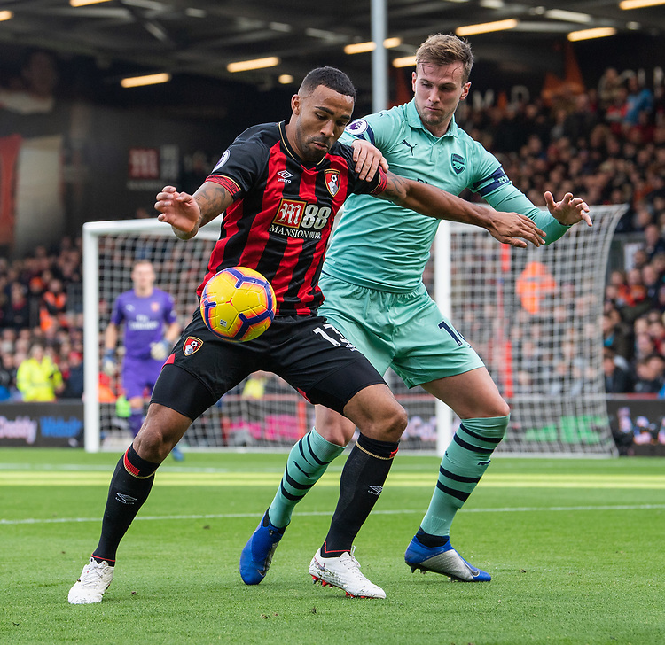 Bournemouth's Callum Wilson (left) is tackled by Arsenal's Rob Holding (right) <br /> <br /> Photographer David Horton/CameraSport<br /> <br /> The Premier League - Bournemouth v Arsenal - Sunday 25th November 2018 - Vitality Stadium - Bournemouth<br /> <br /> World Copyright © 2018 CameraSport. All rights reserved. 43 Linden Ave. Countesthorpe. Leicester. England. LE8 5PG - Tel: +44 (0) 116 277 4147 - admin@camerasport.com - www.camerasport.com