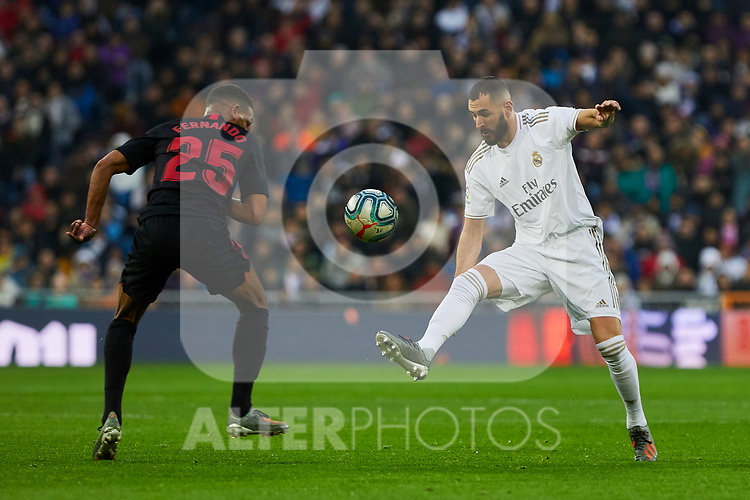Karim Benzema of Real Madrid and Fernando Reges of Sevilla FC during La Liga match between Real Madrid and Sevilla FC at Santiago Bernabeu Stadium in Madrid, Spain. January 18, 2020. (ALTERPHOTOS/A. Perez Meca)
