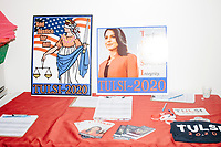 Campaign poster, stickers, buttons, and bracelets, are seen on the check-in table as Democratic presidential candidate and Hawaii representative (D-HI 2nd) Tulsi Gabbard speaks at a campaign event at Weare Public Library in Weare, New Hampshire, on Thu., September 5, 2019.