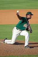Greensboro Grasshoppers relief pitcher Esmerling De La Rosa (31) in action against the Kannapolis Intimidators at CMC-NorthEast Stadium on August 31, 2014 in Kannapolis, North Carolina.  The Grasshoppers defeated the Intimidators 3-1.  (Brian Westerholt/Four Seam Images)