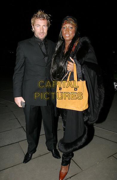 MICA PARIS.The Tio Pepe/Carlton London Restaurant Awards 2004.Grosvenor House.08 March 2004.full length, full-length, tan orange bag.www.capitalpictures.com.sales@capitalpictures.com.© Capital Pictures.