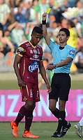 MEDELLIN- COLOMBIA - 23 - 07 - 2017: Lisandro Castillo referee central muestra la tarjeta amarilla a  Fainer Torijano jugador del Deportes Tolima durante partido entre Atlético Nacional y Deportes Tolima, de la fecha 4 por la Liga Aguila II 2017 en el estadio Atanasio Girardot  de Medellín. / Central referee Lisandro Castillo  shows the yellow card to Fainer Torijano player of Deportes Tolima during a match of the date 4nd for the Liga Aguila II 2017 at the Atanasio Girardot Stadium in Medellin  city. Photo: VizzorImage  / León Monsalve / Cont.