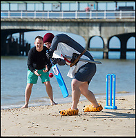 BNPS.co.uk (01202 558833)<br /> Pic: PhilYeomans/BNPS<br /> <br /> King Arthur playing cricket - The Hen &amp; Stag season is well under way on Bmth beach.<br /> <br /> Holidaymakers make the most of the first hot weekend of the year on Bmthn beach today.