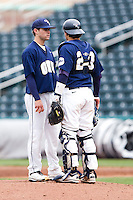 Alec Smith (8) of the Oral Roberts Golden Eagles stands on the mound with Brett Burch (20) during a game against the Missouri State Bears on March 27, 2011 at Hammons Field in Springfield, Missouri.  Photo By David Welker/Four Seam Images