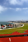 USA, California, San Francisco, an elevated view of Crissy Field and the San Francisco Bay, downtown San Francisco and the Palace of Fine Arts in the distance