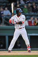 Left fielder Kyri Washington (21) of the Greenville Drive bats in a game against the Asheville Tourists on Thursday, April 7, 2016, at Fluor Field at the West End in Greenville, South Carolina. Greenville won, 4-3. (Tom Priddy/Four Seam Images)