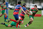Ardmore Marist prop R. Fua'aletoelau looks to get his pass to A. Te Pou as he is tackled by S. Kata. Waiuku's S. Betty has his eyes on the ball as well. Counties Manukau Premier Club Rugby, Ardmore Marist vs Waiuku played at Bruce Pulman Park, Papakura on the 29th of April 2006. Ardmore Marist won 10 - 9.