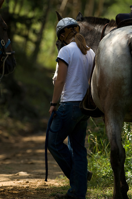 Girl and a horse at Cheley Camp, summer camp, Estes Park, Colorado, USA, not released
